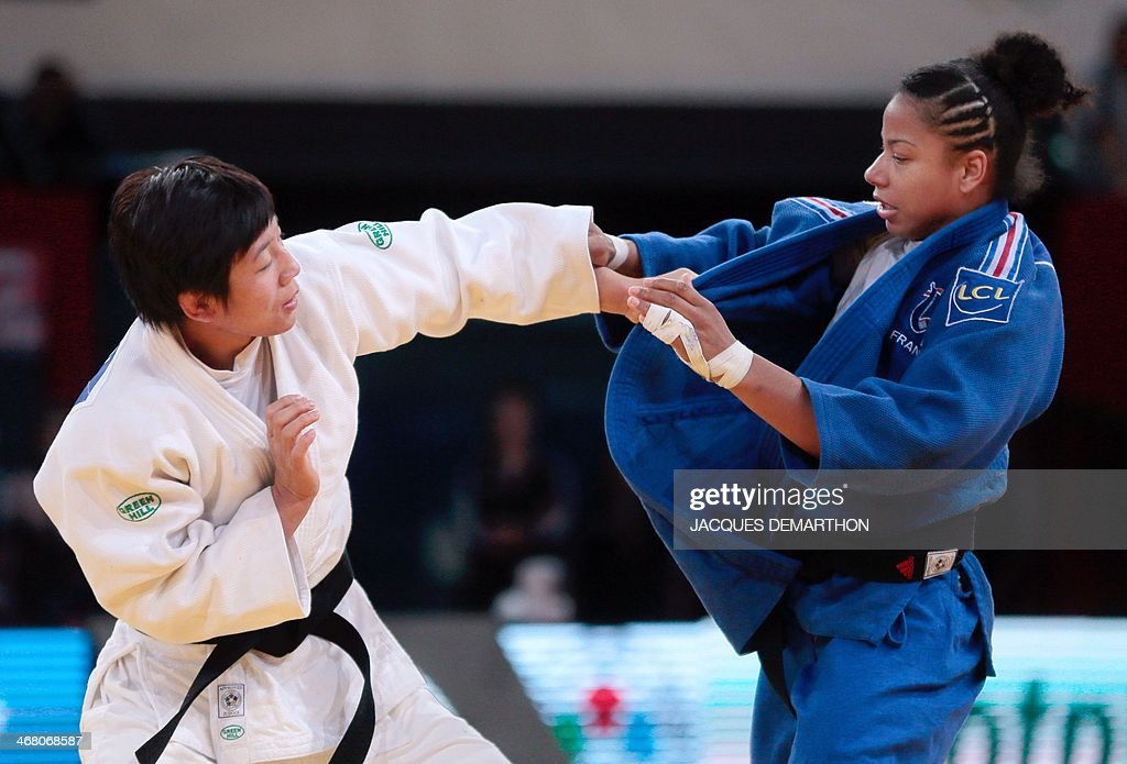 China's Chen Fei grapples with France's Fanny Estelle Posvite during the women's 70kg semifinals at the 2014 Paris Judo Grand Slam tournament on...