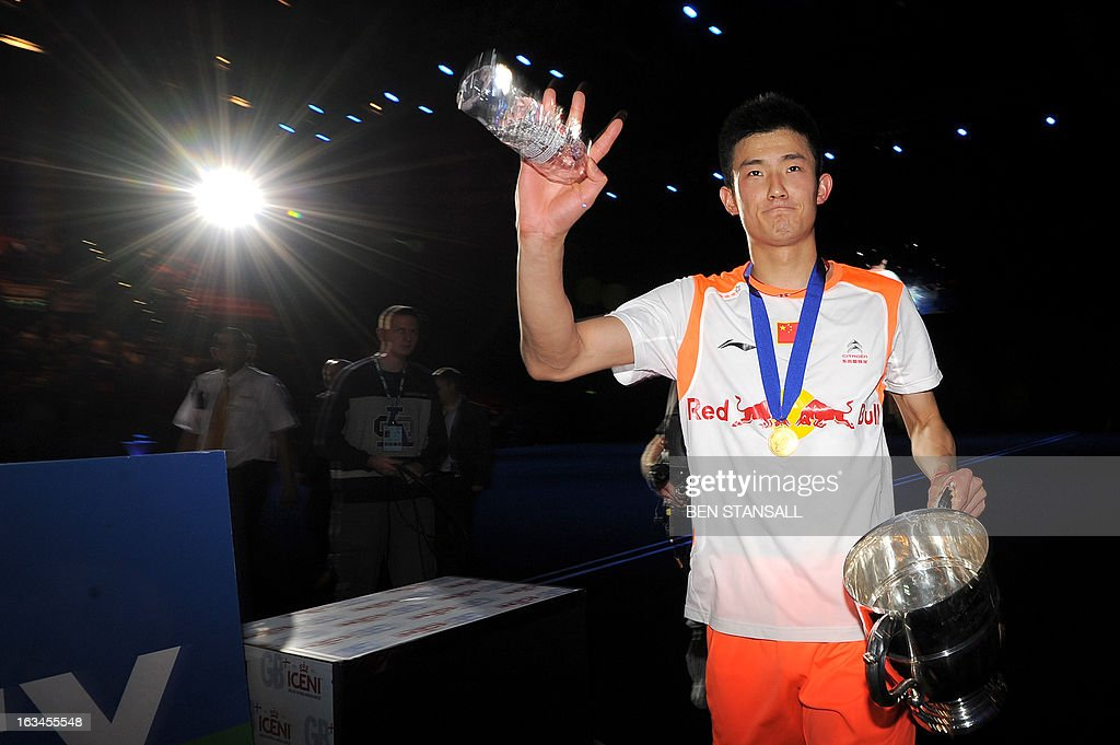 China's Chen Long celebrates after winning the All England Open Badminton Championships men's singles final match against Malaysia's Lee Chong Wei in Birmingham, central England, on March 10, 2013. AFP PHOTO/BEN STANSALL