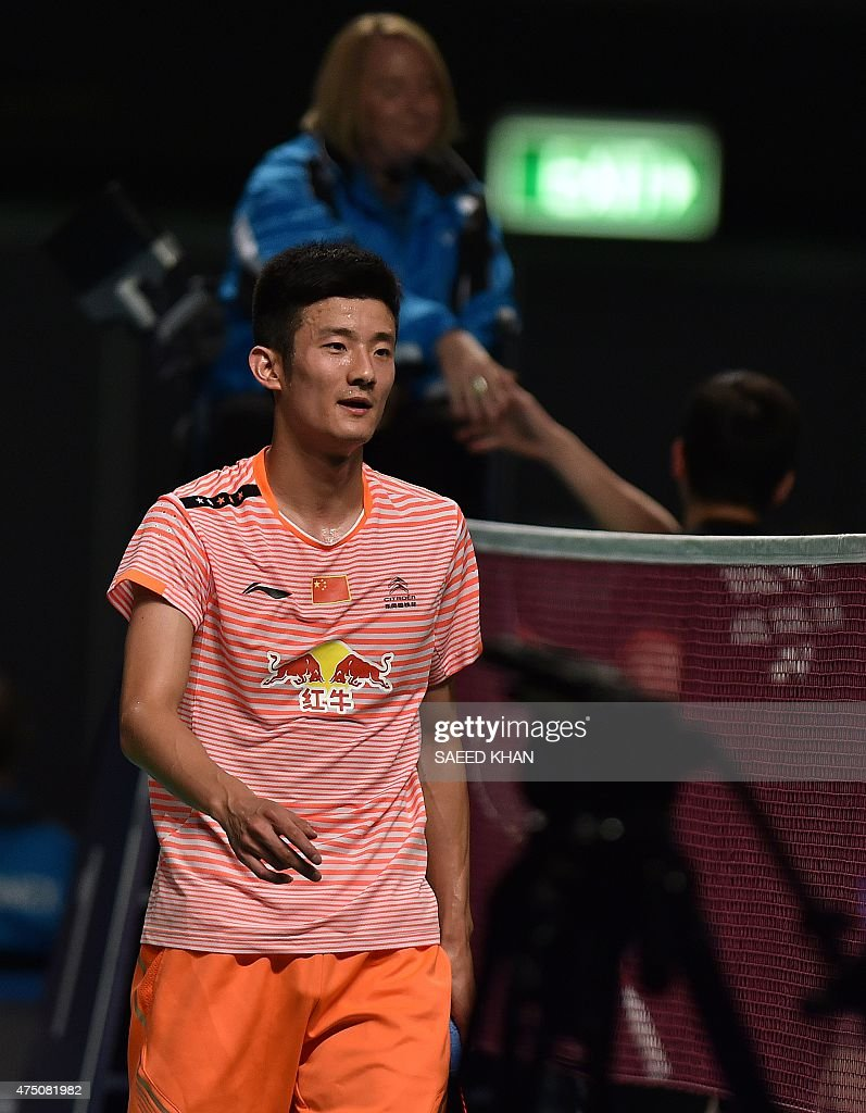 China s Chen Long celebrates his victory against Wong Wing Ki