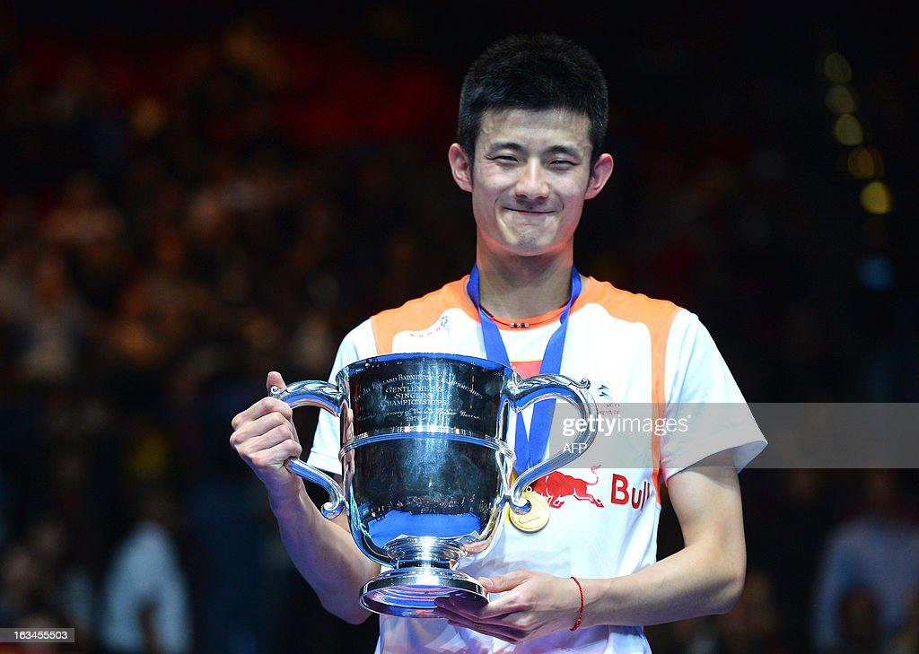 China's Chen Long poses with his trophy after winning the All England Open Badminton Championships men's singles final match against Malaysia's Lee Chong Wei in Birmingham, central England, on March 10, 2013.