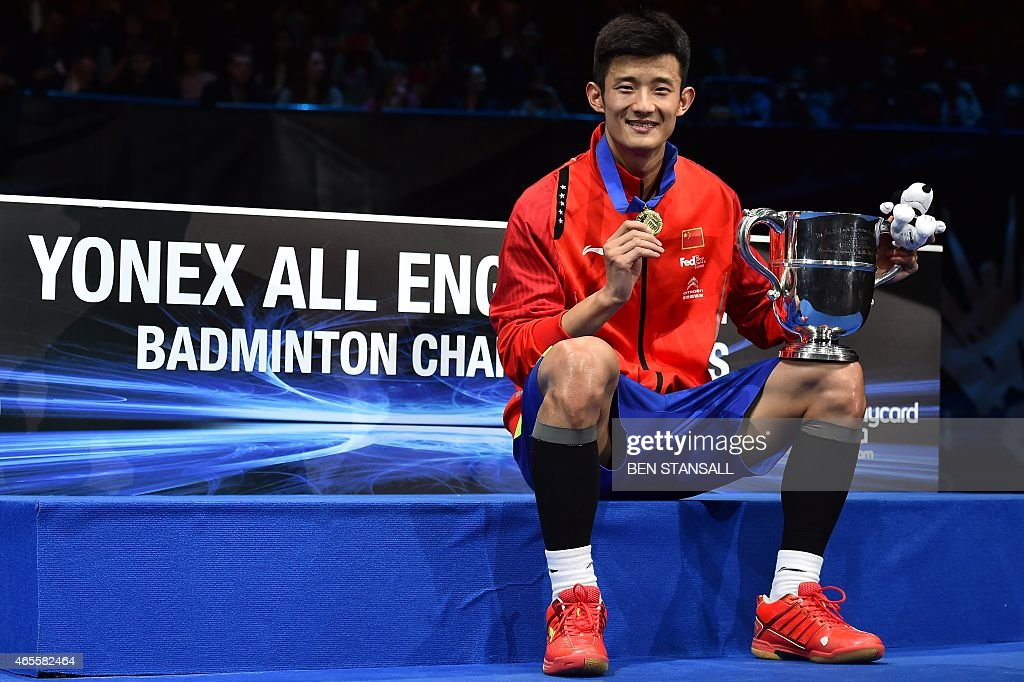 China's <a gi-track='captionPersonalityLinkClicked' href=/galleries/search?phrase=Chen+Long+-+Badminton+Player&family=editorial&specificpeople=9613842 ng-click='$event.stopPropagation()'>Chen Long</a> poses with his trophy following victory over Denmark's Jan Jorgensen (not pictured) in their All England Open Badminton Championships men's singles final match in Birmingham, central England, on March 8, 2015.