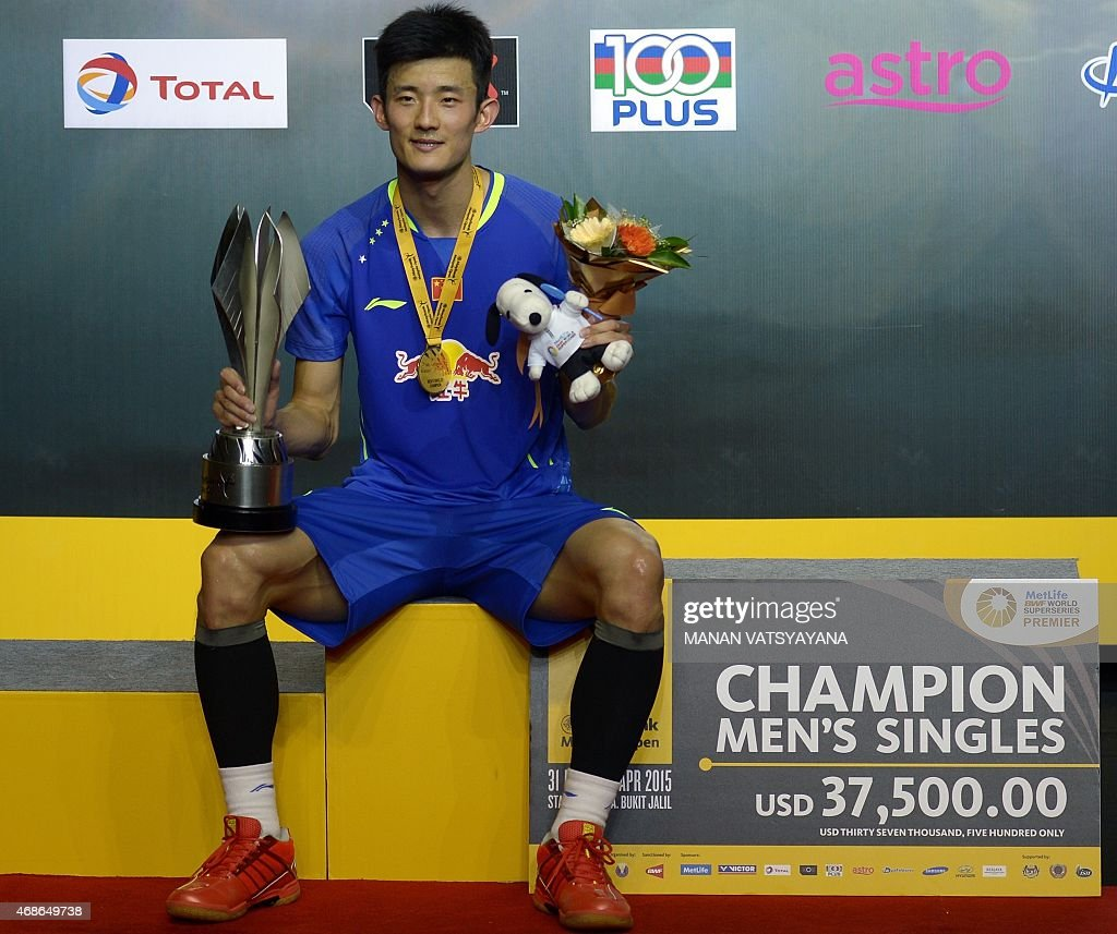 Chen Long poses with the trophy after defeating patriot Lin Dan