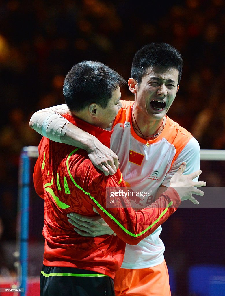 China's Chen Long (E) reacts after winning the All England Open Badminton Championships men's singles final match against Malaysia's Lee Chong Wei in Birmingham, central England, on March 10, 2013.