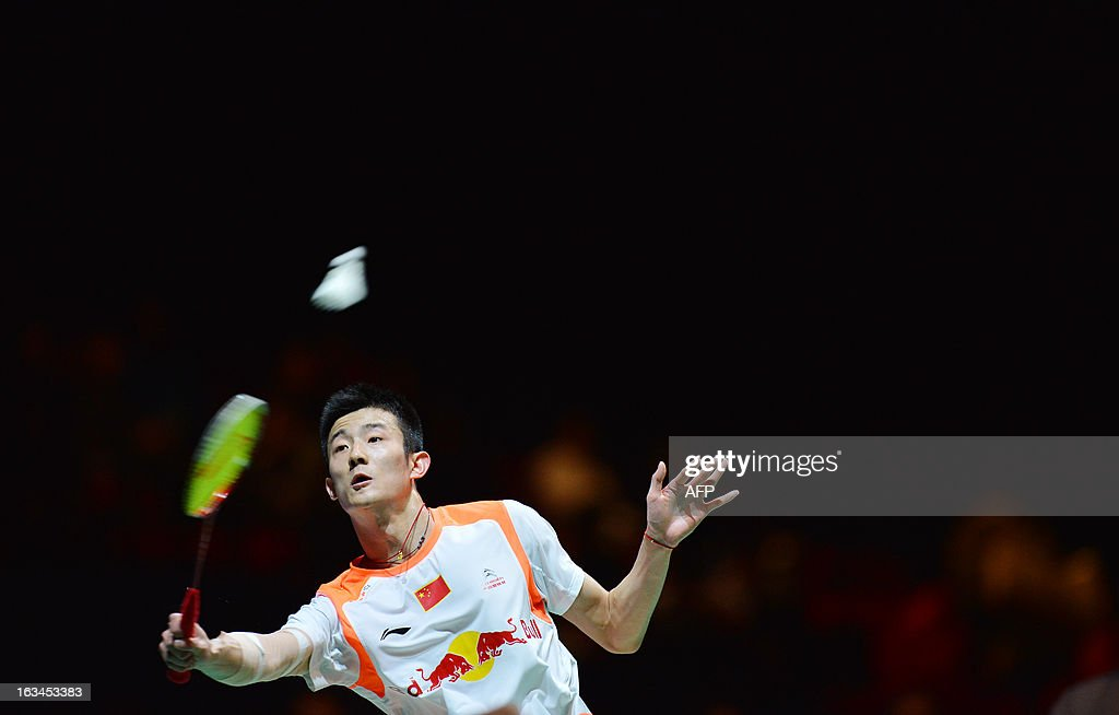 China's Chen Long returns to Malaysia's Lee Chong Wei during their All England Open Badminton Championships men's singles final match in Birmingham, central England, on March 10, 2013. AFP PHOTO/BEN STANSALL