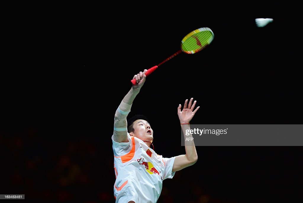 China's Chen Long returns to Malaysia's Lee Chong Wei during their All England Open Badminton Championships men's singles final match in Birmingham, central England, on March 10, 2013.