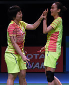China's Chen Quingchen and Bao Yixin celebrate their victory in the women's doubles final against Indonesia's Nitya Krishinda Maheswari and Greysia...