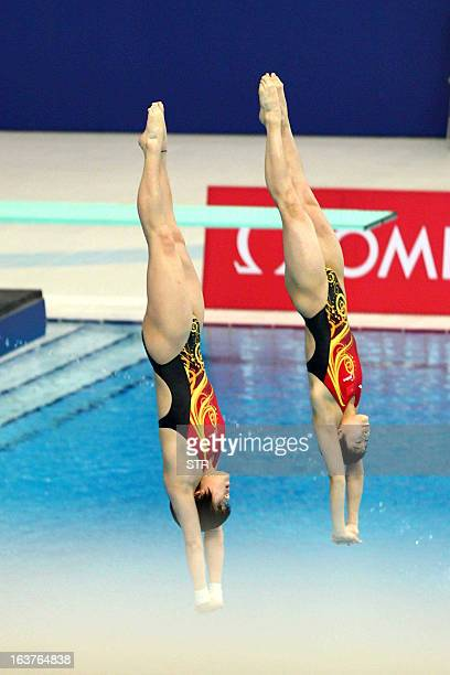 China's Chen Ruolin and Liu Huixia complete a dive in the 10m Platform Synchro women's event during the FINA Diving World Series in Beijing on March...