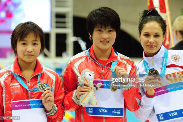 China's Chen Ruolin with her gold medal China's Ho Yadan with her silver medal and Russia's Yulia Koltunova with bronze after the Women's 10m...
