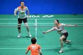 China's Cheng Shu returns as her partner China's Zhao Yunlei stands ready against China's Wang Xiaoli and Yu Yang during their All England Open...