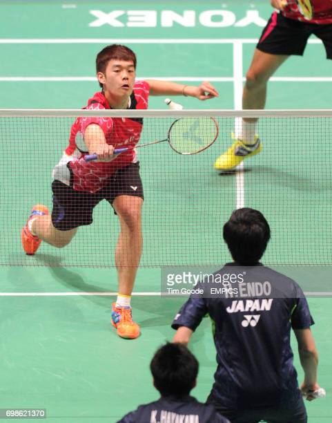 China's ChiLin Wang plays a shot during his doubles match during day two of the 2015 Yonex All England Badminton Championships at the Barclaycard...