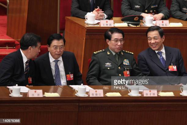 China's Chongqing Municipality Communist Party Secretary Bo Xilai and Party Secretary of the Guangdong Province Wang Yang attend the third plenary...