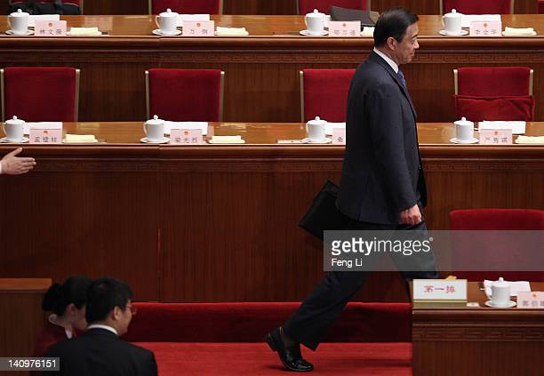 China's Chongqing Municipality Communist Party Secretary Bo Xilai walks as he arrives for the third plenary meeting of the National People's Congress...