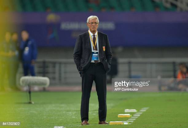 China's coach Marcello Lippi watches from the sidelines during the World Cup football qualifying match between China and Uzbekistan in Wuhan in...