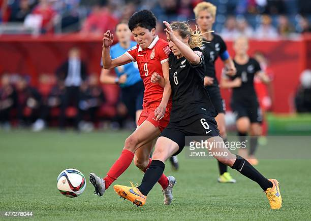 China's defender Wang Sanshan and New Zealand's defender Rebekah Stott vie for the ball during their Group A football match of the 2015 FIFA Women's...