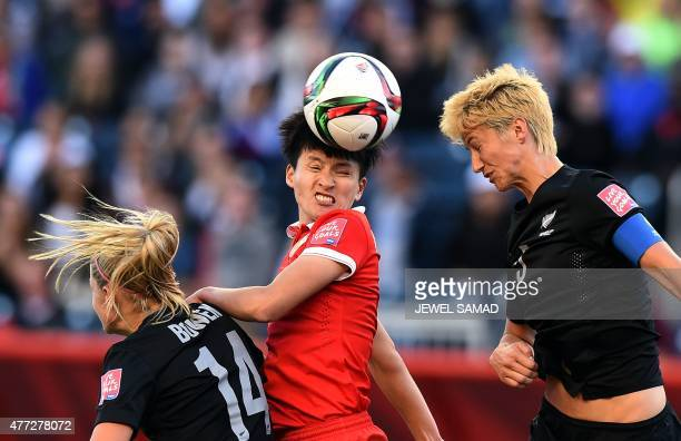 China's defender Wang Sanshan vies for the ball with New Zealand's defender Abby Erceg and midfielder Annalie Longo during their Group A football...