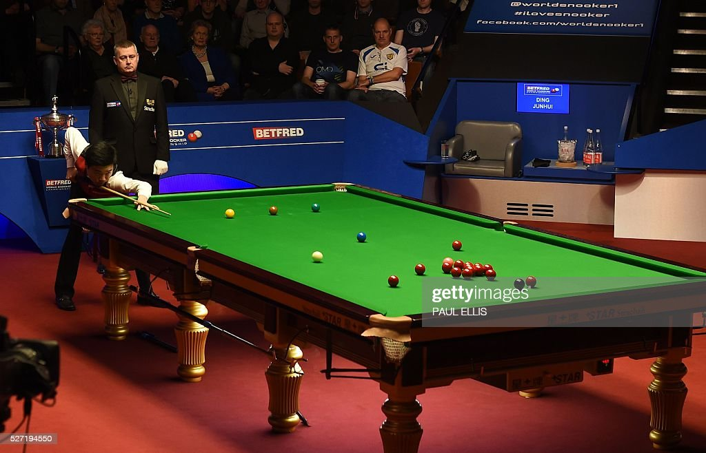 China's Ding Junhui plays a shot during the third session of the World Snooker Final against England's Mark Selby in Sheffield, northern England on May 2, 2016. / AFP / PAUL