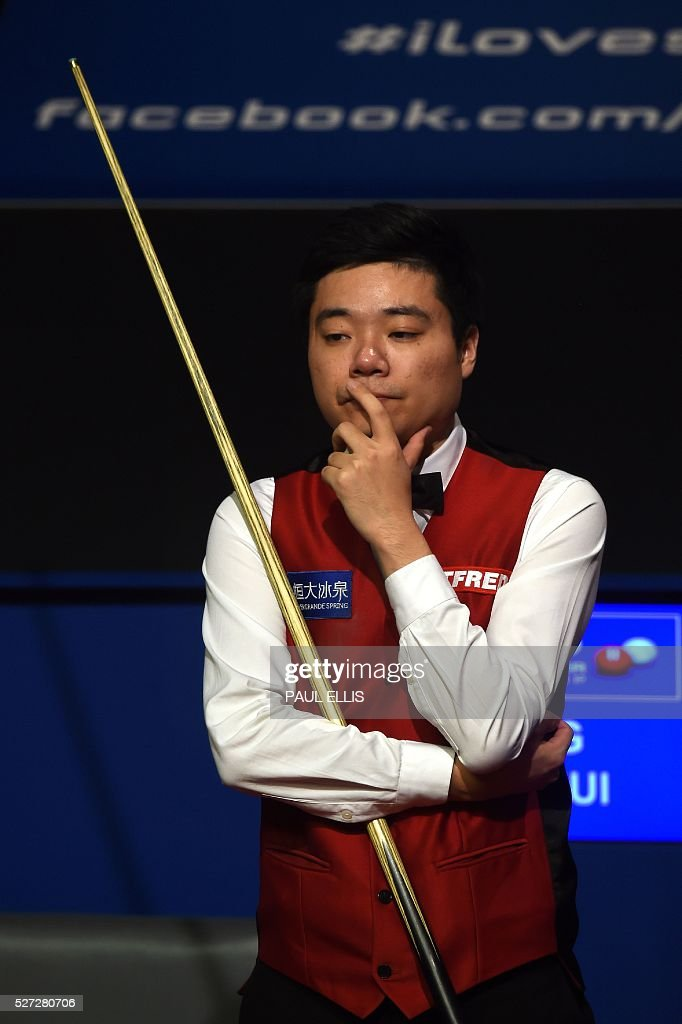 China's Ding Junhui reacts during the final session of the final of the World Snooker Championship against England's Mark Selby at the Crucible theatre in Sheffield, northern England, on May 2, 2016. / AFP / PAUL