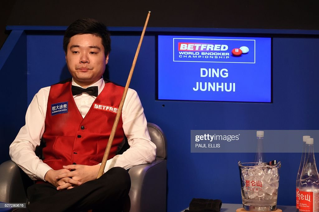 China's Ding Junhui sits in his place during the final session of the final of the World Snooker Championship against England's Mark Selby at the Crucible theatre in Sheffield, northern England, on May 2, 2016. / AFP / PAUL