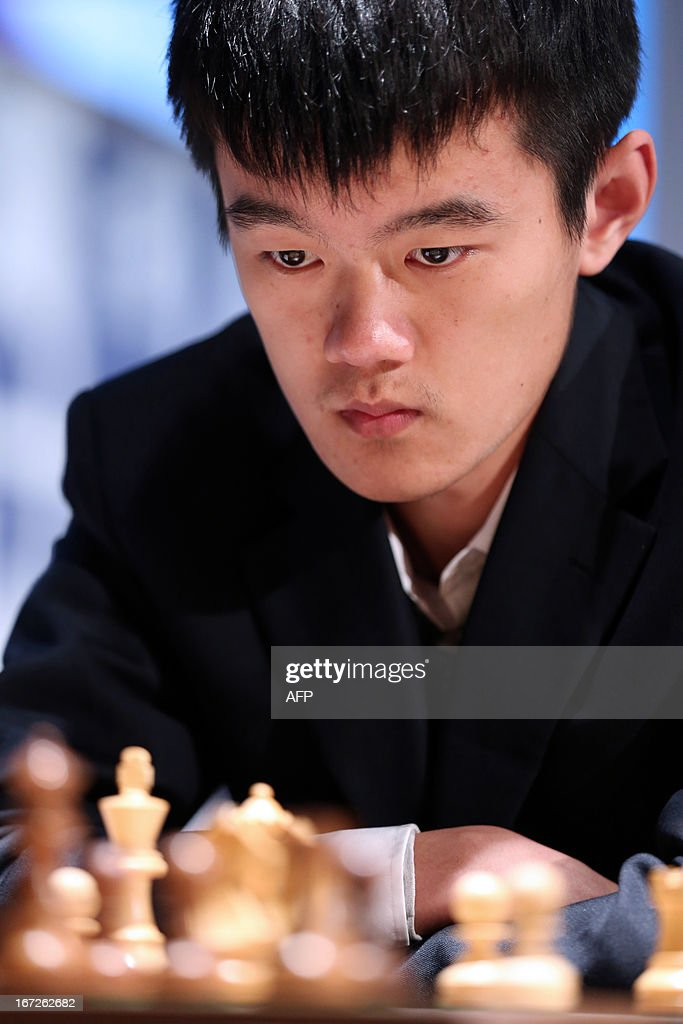 China's Ding Liren concentrates prior to play a move during a round 3 game of the Alekhine Memorial chess tournament on April 23, 2013 in Paris. The tournament is a 10-player single round competition, with the first half held in Paris from April 20 to 25, and the second half in the Russian State Museum in St. Petersburg from April 26 to May 1st.