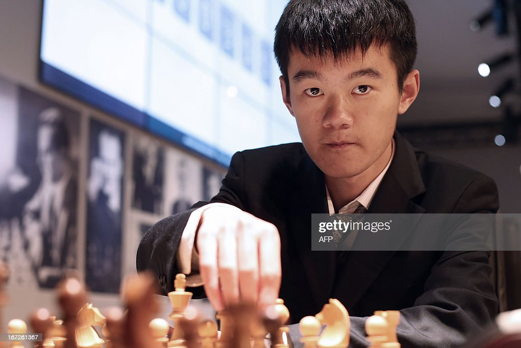 China's Ding Liren plays a move during a round 3 game of the Alekhine Memorial chess tournament on April 23, 2013 in Paris. The tournament is a 10-player single round competition, with the first half held in Paris from April 20 to 25, and the second half in the Russian State Museum in St. Petersburg from April 26 to May 1st.