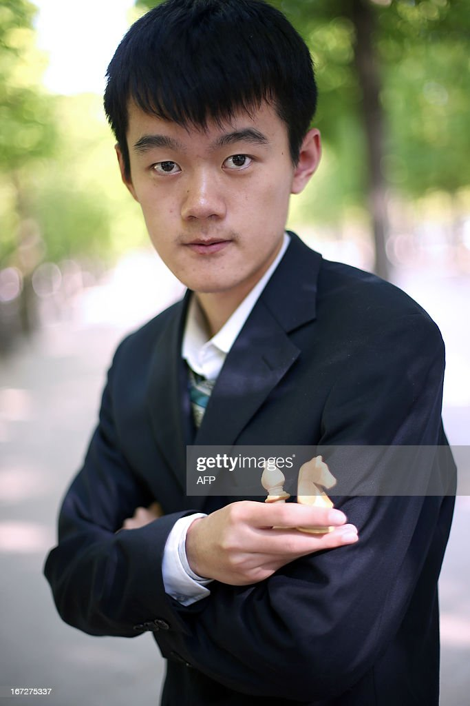 China's Ding Liren poses during the Alekhine Memorial chess tournament on April 23, 2013 in Paris. The tournament is a 10-player single round competition, with the first half held in Paris from April 20 to 25, and the second half in the Russian State Museum in St. Petersburg from April 26 to May 1st. AFP PHOTO / THOMAS SAMSON