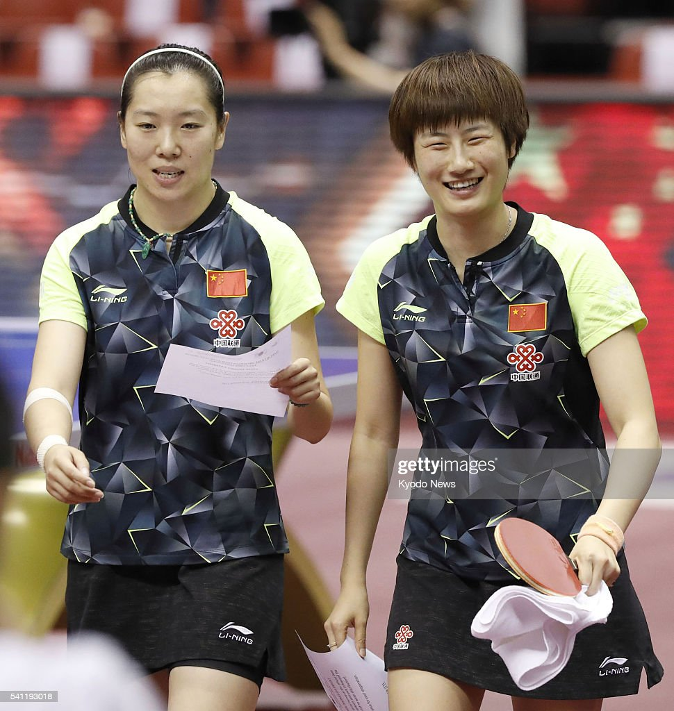 China's <a gi-track='captionPersonalityLinkClicked' href=/galleries/search?phrase=Ding+Ning+-+Table+Tennis+Player&family=editorial&specificpeople=2161349 ng-click='$event.stopPropagation()'>Ding Ning</a> (R) and Li Xiaoxia smile after defeating compatriots Liu Shiwen and Zhu Yuling 3-0 in the women's doubles final of the International Table Tennis Federation (ITTF) World Tour Japan Open in Tokyo on June 19, 2016.