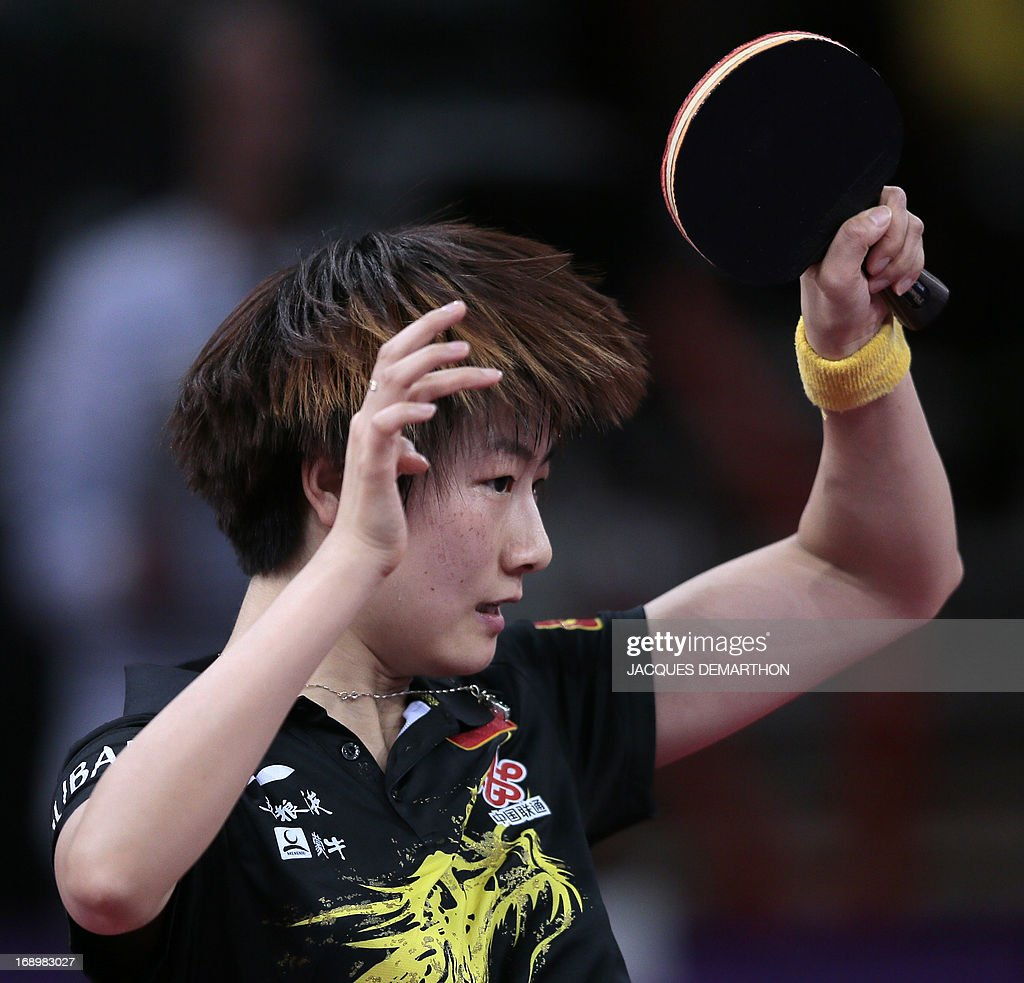 China's Ding Ning returns a ball to North Korea's Ri Myong-Sun on May 18, 2013 in Paris, during the quater-finals of the women's singles of the World Table Tennis Championships.