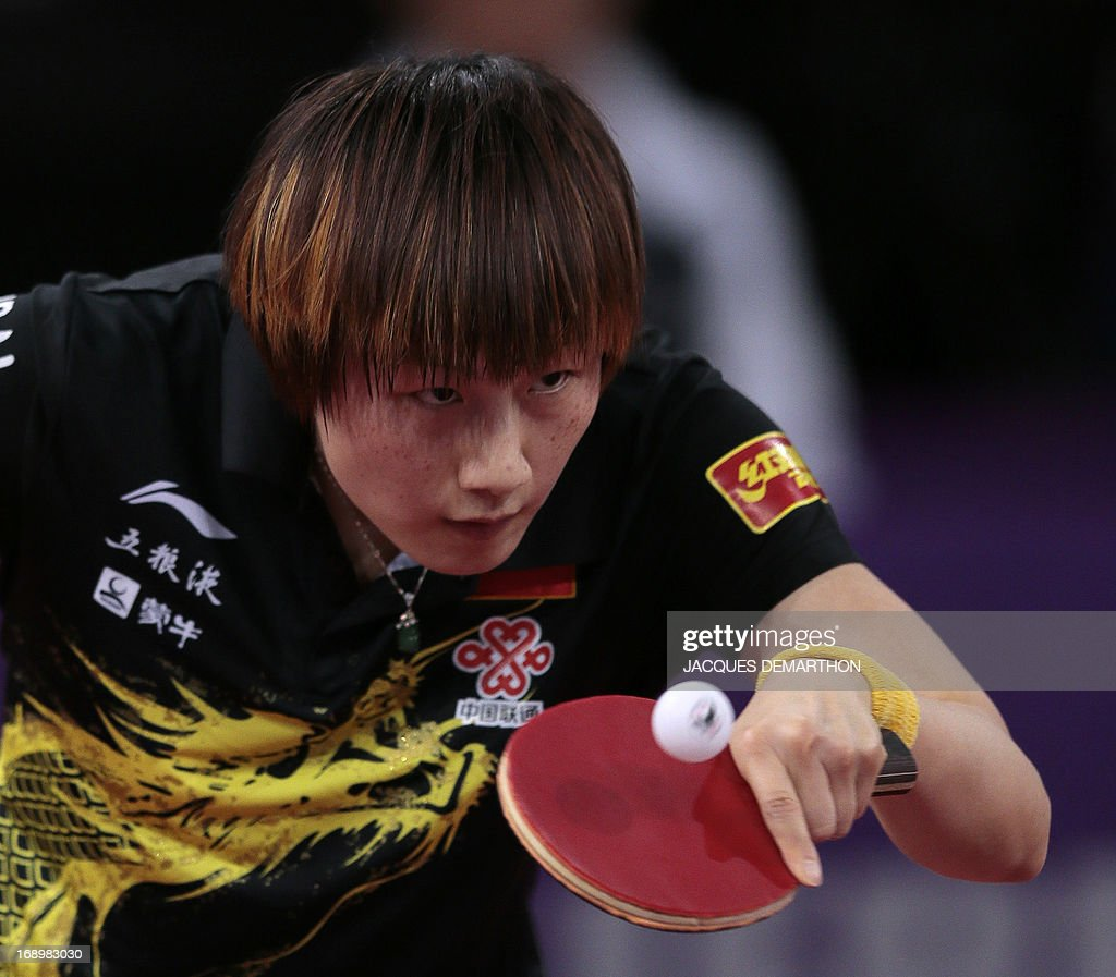 China's Ding Ning returns a ball to North Korea's Ri Myong-Sun on May 18, 2013 in Paris, during the quater-finals of the women's singles of the World Table Tennis Championships. AFP PHOTO / JACQUES DEMARTHON