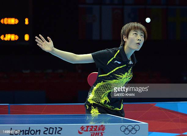 China's Ding Ning serves to Japan's Kasumi Ishikawa during the 2012 London Olympic Games table tennis women's team gold medal matches at the ExCeL...