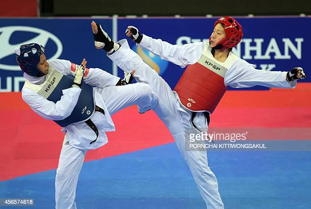 China's Donghua Li competes against Iran's Akram Khodabandeh during the taekwondo women 73kg final round at Ganghwa Dolmens Gymnasium during the 17th...