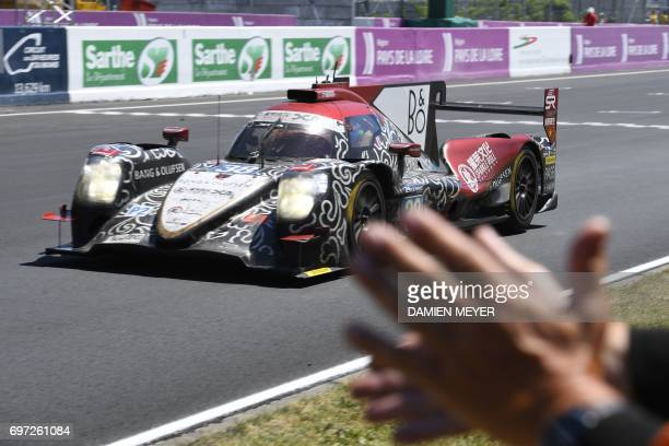 China's driver HoPin Tung on his Jackie Chan Racing ORECA 07Gibson N°38 crosses the finish line finishing second of the Le Mans 24 hours endurance...