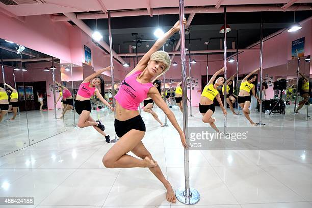 China's Fang Yi a dancer who has competed in the finals of the 2015 World Pole Dance Championships shows pole dance at a pole dance training center...