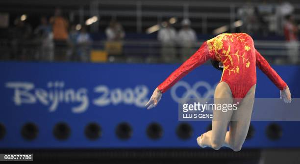 China's Fei Cheng competes on the floor during the women's qualification of the artistic gymnastics event of the Beijing 2008 Olympic Games in...