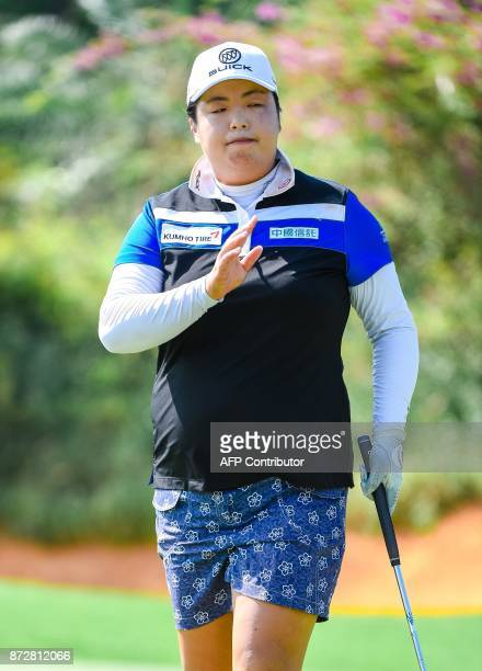 China's Feng Shanshan gestures during the Blue Bay LPGA golf tournament at Jian Lake Blue Bay Golf Course on China's southern Hainan island on...