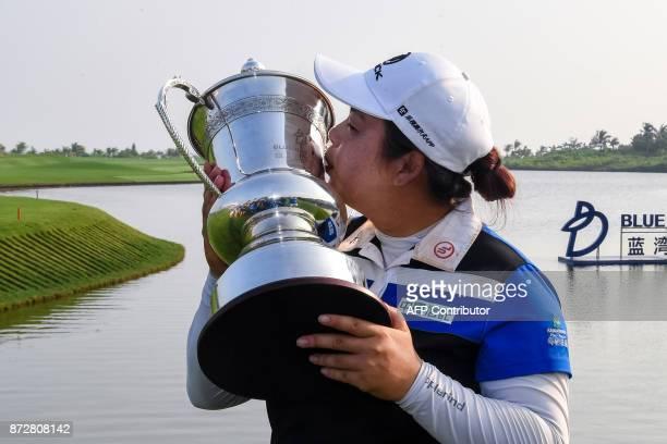 China's Feng Shanshan kisses the trophy after winning the Blue Bay LPGA golf tournament at Jian Lake Blue Bay Golf Course on China's southern Hainan...
