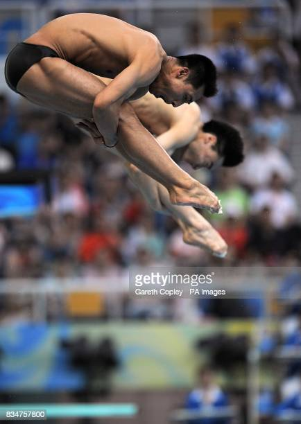China's Feng Wang and Kai Qin complete in the Men's synchronised 3 metre springboard diving at the National Aquatics Centre during the 2008 Beijing...