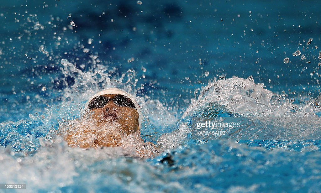China's Fenglin Zhang competes in the men's 200m backstroke final during the 9th Asian Swimming Championships in Dubai on November 16, 2012.
