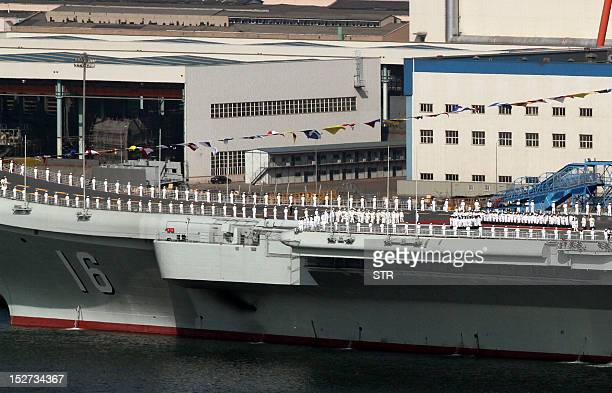 China's first aircraft carrier the 'Liaoning' sits berthed at the naval base in Dalian northeast China's Liaoning province China's first aircraft...