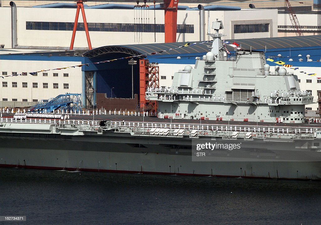 China's first aircraft carrier, the 'Liaoning' sits berthed at the naval base in Dalian, northeast China's Liaoning province. China's first aircraft carrier, a former Soviet ship it bought from Ukraine and refurbished, entered service on September 25, the defence ministry in Beijing said. CHINA