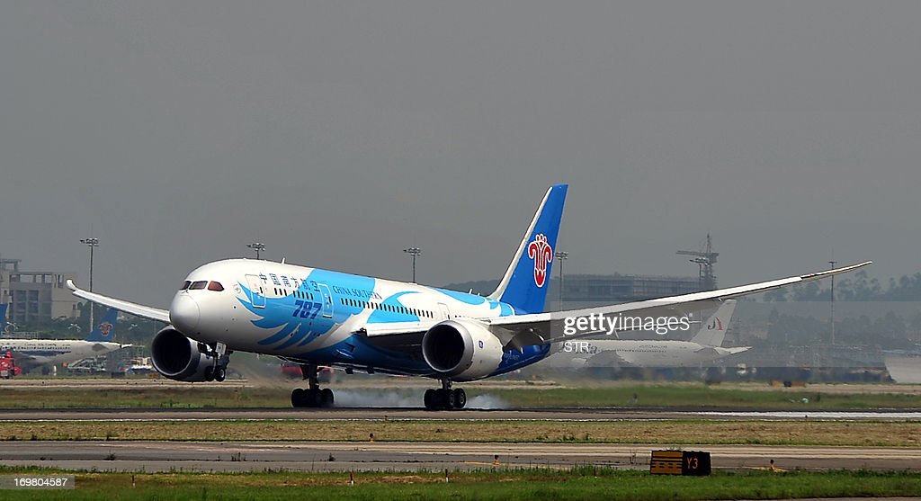 China's first Boeing 787 Dreamliner delivered to China Southern Airlines lands at the airport in Guangzhou southern China's Guangdong province on...