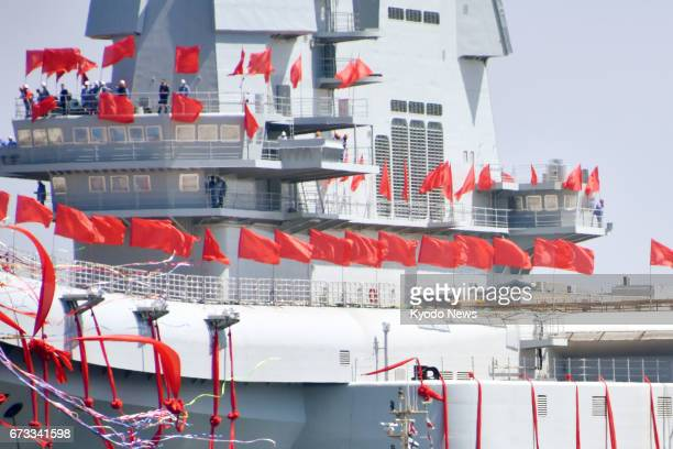 China's first domestically built aircraft carrier is launched at a shipyard in the northeastern port city of Dalian on April 26 2017 ==Kyodo
