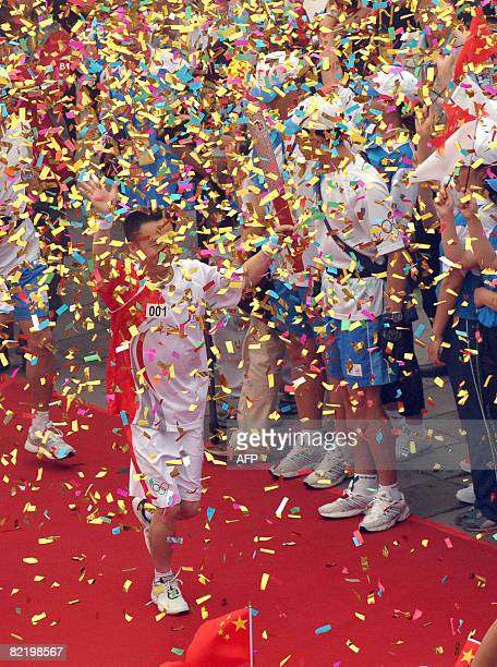 China's first man in space Yang Liwei carries the Olympic torch as the day's first torchbearer along a section of the Great Wall in Badaling outside...
