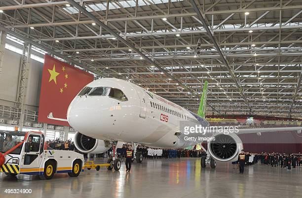 China's first selfdeveloped large passenger jetliner C919 is presented after it rolled off the production line at Shanghai Aircraft Manufacturing Co...