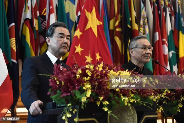 China's Foreign Minister Wang Yi and Thai Foreign Minister Don Pramudwinai stand together during a joint press conference at the Ministry of Foreign...