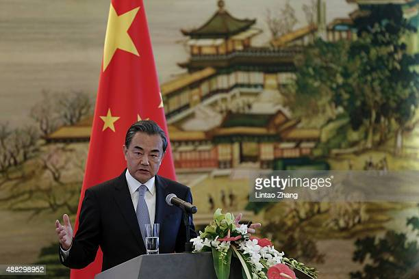 Chinas Foreign Minister Wang Yi answer questions during a press conference after meeting with Iranian Foreign Minister Javad Zarif on September 15...