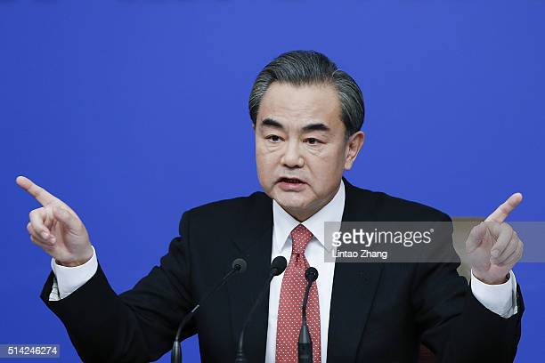 China's foreign minister Wang Yi attends a press conference during the Fourth Session of the 12th National People's Congress on March 8 2016 in...