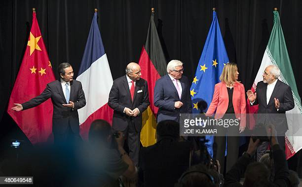 China's Foreign Minister Wang Yi French Foreign Minister Laurent Fabius German Minister for Foreign Affairs FrankWalter Steinmeier High...