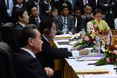 CORRECTION China's Foreign Minister Wang Yi Japan's Foreign Minister Fumio Kishida and South Korea's Foreign Minister Yun Byungse attend the ASEAN...