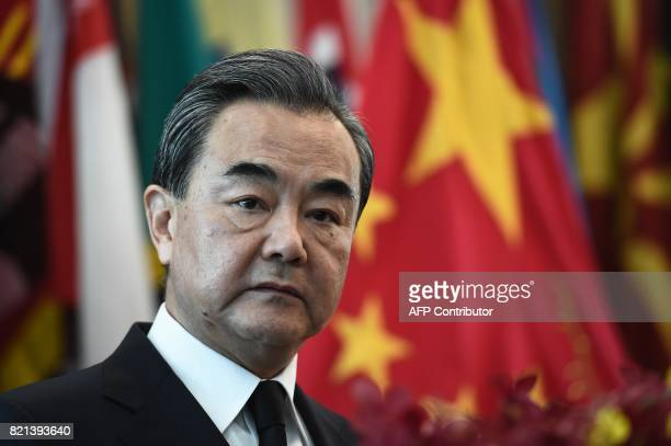 China's Foreign Minister Wang Yi listens during a joint press conference with Thai Foreign Minister Don Pramudwinai at the Ministry of Foreign...