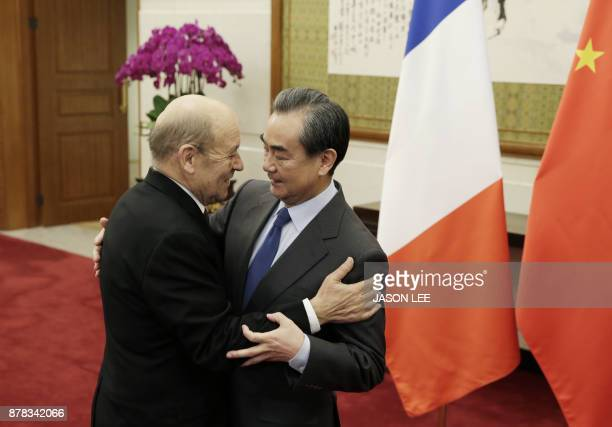 China's Foreign Minister Wang Yi meets French Foreign Minister JeanYves Le Drian at Diaoyutai State Guesthouse in Beijing on November 24 2017 / AFP...